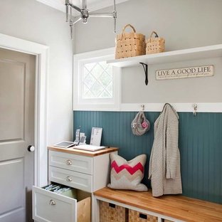 Inspiration for a mid-sized beach style dark wood floor mudroom remodel in Atlanta with gray walls
