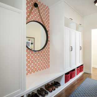 Large transitional medium tone wood floor mudroom photo in San Francisco with white walls