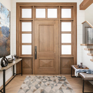 Inspiration for a huge farmhouse light wood floor and beige floor entryway remodel in Salt Lake City with white walls and a medium wood front door