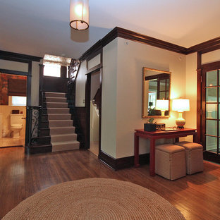 Foyer - traditional foyer idea in Chicago with beige walls