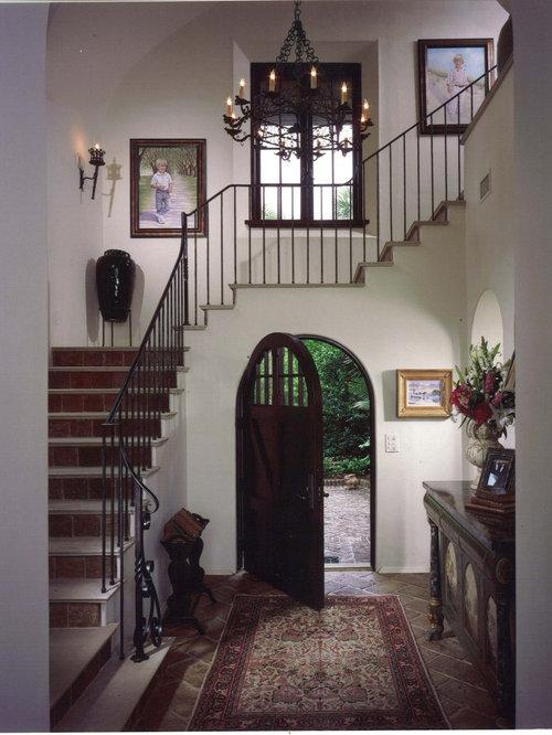 entryway idea in atlanta with a dark wood front door