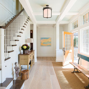 Entryway - traditional light wood floor and beige floor entryway idea in Minneapolis with white walls and a yellow front door