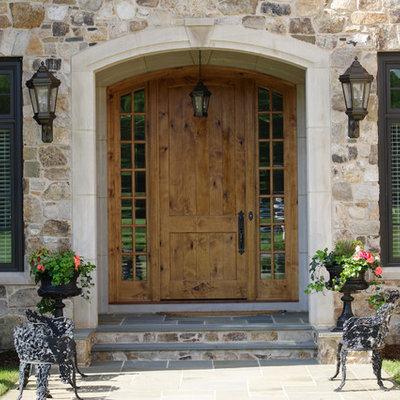 Entryway - traditional entryway idea in Richmond with a medium wood front door