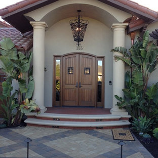 Example of a tuscan double front door design in San Francisco