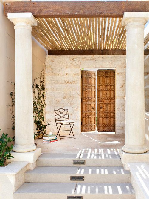 Mediterranean Entryway Idea In Los Angeles With A Double Front Door
