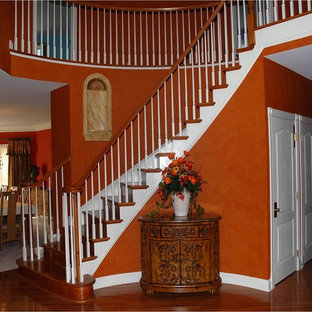 Inspiration for a timeless foyer remodel in Philadelphia with orange walls
