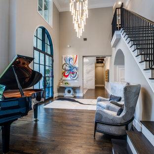 На фото: огромное фойе в стиле современная классика с серыми стенами, паркетным полом среднего тона, двустворчатой входной дверью, черной входной дверью, коричневым полом и многоуровневым потолком
