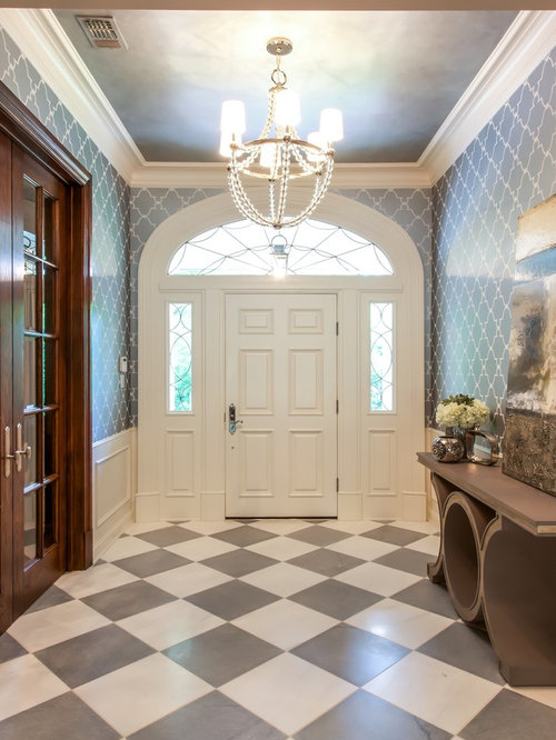 Expansive transitional entryway design ideas remodels for Transitional foyer ideas