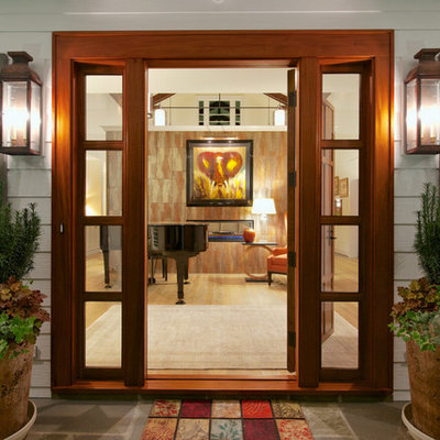 Large elegant entryway photo in Raleigh with a medium wood front door