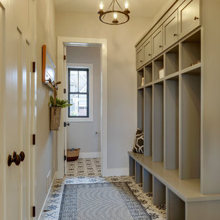 Example of a cottage porcelain tile and gray floor mudroom design in Minneapolis with gray walls