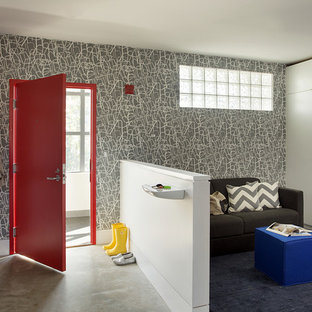 Photo of a mid-sized contemporary mudroom in Boston with multi-coloured walls, concrete floors, a single front door and a red front door.