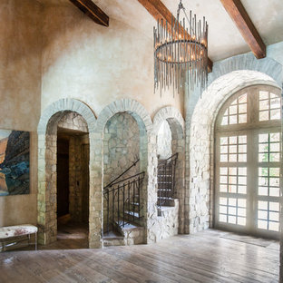 Example of a large transitional medium tone wood floor entryway design in Houston with beige walls and a medium wood front door