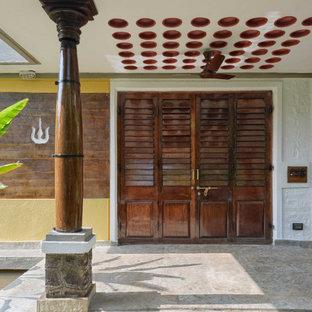 Idee per una grande porta d'ingresso country con pareti multicolore, pavimento in granito, una porta a due ante, una porta in legno scuro e pavimento grigio