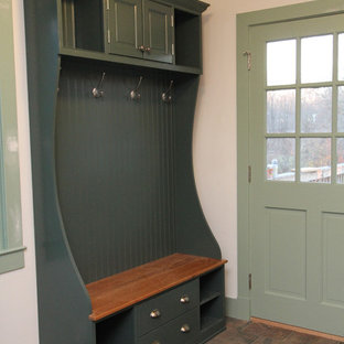 Inspiration for a mid-sized cottage slate floor entryway remodel in Baltimore with white walls and a green front door