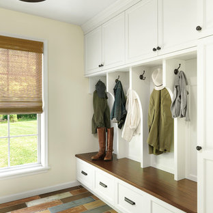 Farmhouse painted wood floor and multicolored floor mudroom photo in St Louis with beige walls