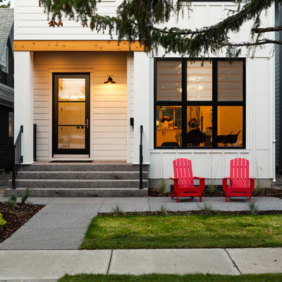 Example of a cottage entryway design in Calgary with a glass front door