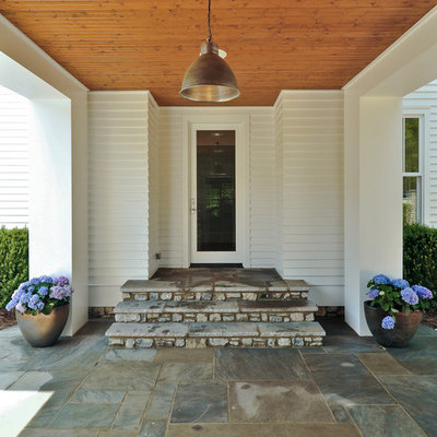 Example of a cottage entryway design in Nashville with a glass front door