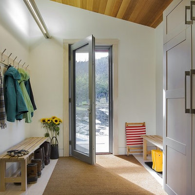 Country light wood floor entryway photo in Boston with white walls and a glass front door