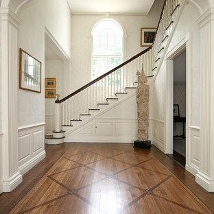 Elegant medium tone wood floor foyer photo in Boston with white walls