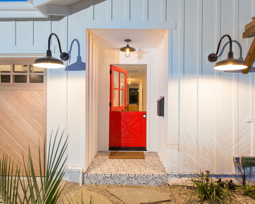 Inspiration For A Mid Sized Farmhouse Entryway Remodel In Los Angeles With  A Red Front
