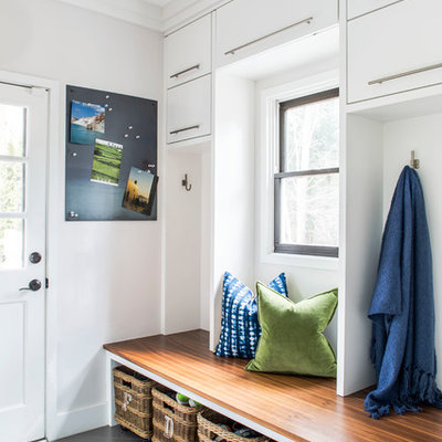 Inspiration for a transitional gray floor entryway remodel in Atlanta with gray walls and a glass front door