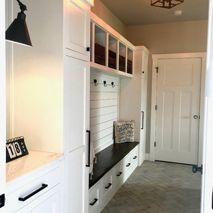 Entryway - mid-sized country ceramic floor and gray floor entryway idea in Other with gray walls and a white front door
