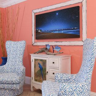 Foto di un ingresso con vestibolo stile marinaro di medie dimensioni con pareti arancioni, pavimento in gres porcellanato, una porta a due ante, una porta bianca e pavimento beige