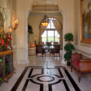 Inspiration for a mid-sized timeless marble floor entry hall remodel in Miami with yellow walls