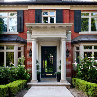 Elegant entryway photo in Toronto with a glass front door