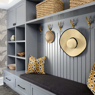 Inspiration for a transitional gray floor mudroom remodel in Toronto with gray walls