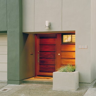Inspiration for a small modern concrete floor and gray floor entryway remodel in San Francisco with a medium wood front door and green walls