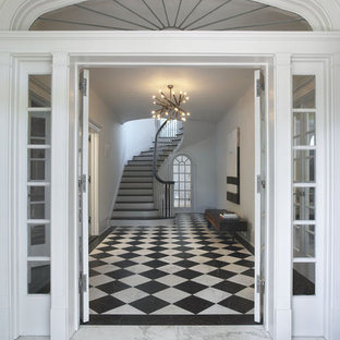 Example of a mid-sized trendy marble floor and multicolored floor entryway design in New York with white walls and a white front door