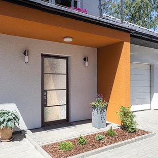 Große Moderne Haustür mit beiger Wandfarbe, Doppeltür und Metalltür in Tampa