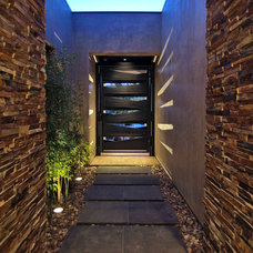 Contemporary Entry by Pinnacle Architectural Studio