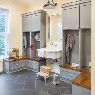 Inspiration for a transitional mudroom remodel in Portland with beige walls