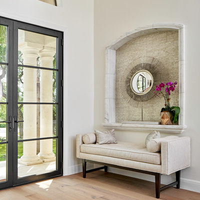 Entryway - large transitional light wood floor and gray floor entryway idea in Austin with white walls and a glass front door