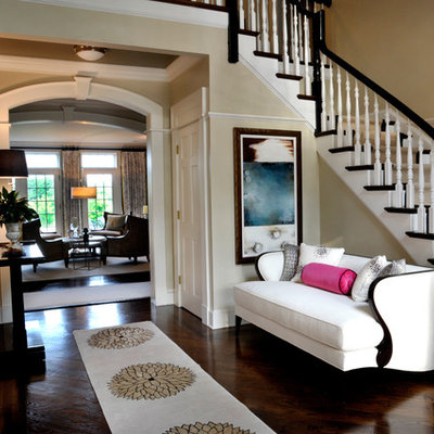 Inspiration for a large timeless dark wood floor entryway remodel in New York with beige walls