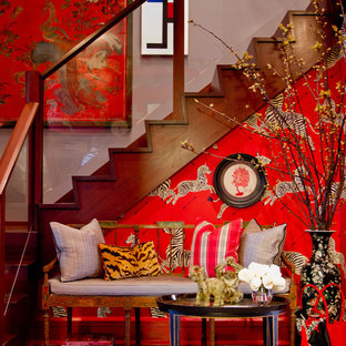 Example of an eclectic entryway design in New York with red walls