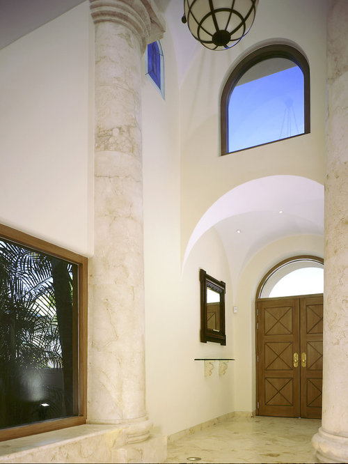 Ex&le of a tuscan entryway design in Mexico City with a medium wood front door & Foyer Door | Houzz pezcame.com