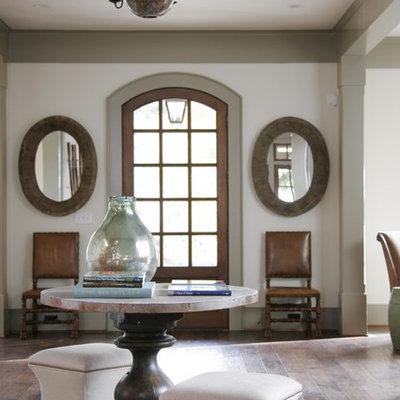 Elegant dark wood floor entryway photo in Atlanta with white walls