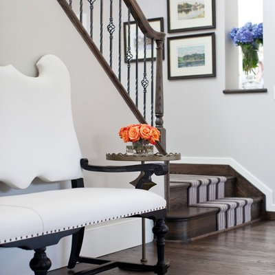 Example of a transitional foyer design in Baltimore with gray walls