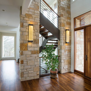 Example of a large transitional dark wood floor entryway design in Chicago with white walls and a medium wood front door