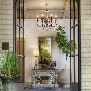 Inspiration for a mid-sized transitional dark wood floor and brown floor entryway remodel in Detroit with beige walls and a glass front door