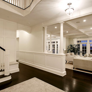 Foyer - large traditional dark wood floor and brown floor foyer idea in Seattle with white walls