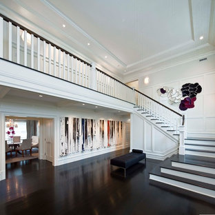 Inspiration for a contemporary dark wood floor foyer remodel in New York with white walls