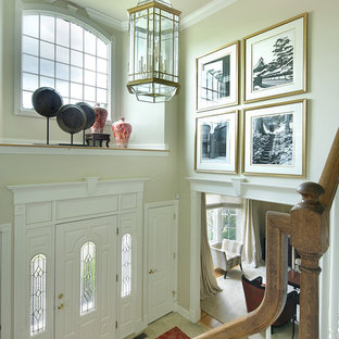 Inspiration for a mid-sized transitional travertine floor and beige floor entryway remodel in New York with beige walls and a white front door