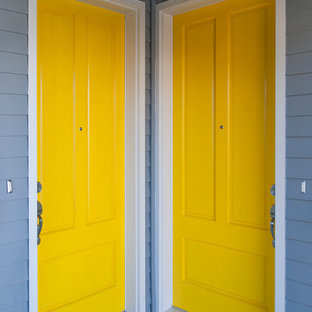 Small trendy entryway photo in Vancouver with gray walls and a yellow front door