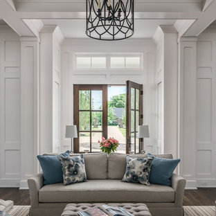 Inspiration for a large cottage dark wood floor and brown floor entryway remodel in Nashville with white walls and a dark wood front door