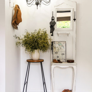 Photo of a shabby-chic style entryway in Perth with white walls and multi-coloured floor.