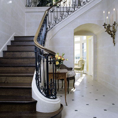 Example of a classic foyer design in Santa Barbara with beige walls